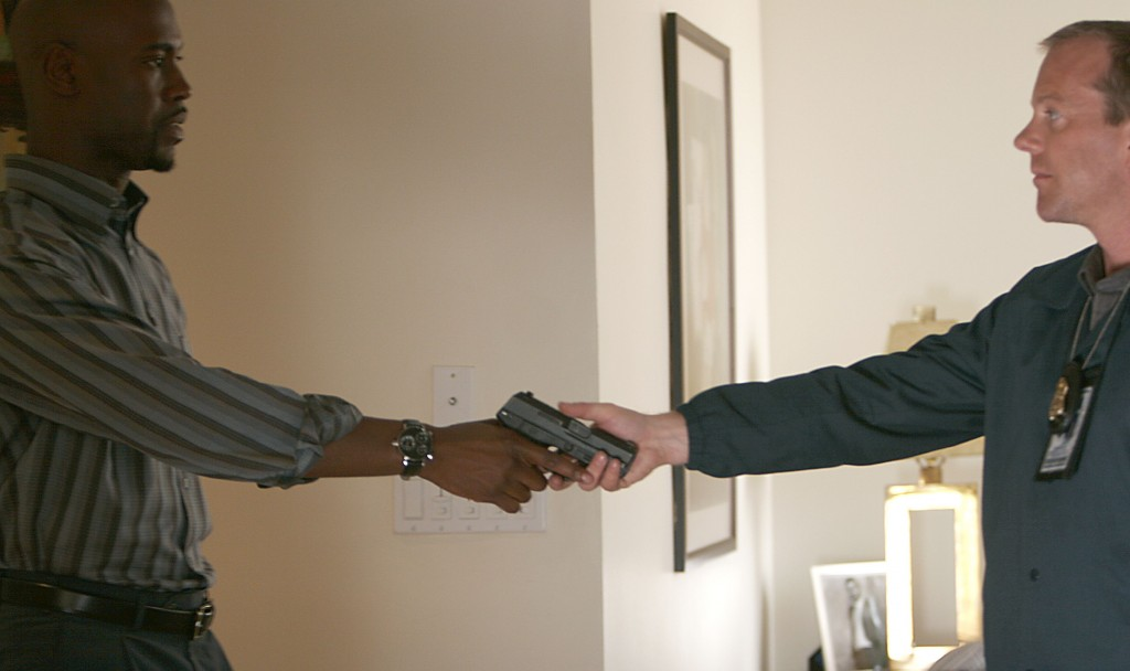 Jack Bauer hands gun to Wayne Palmer in 24 Season 5 Episode 2