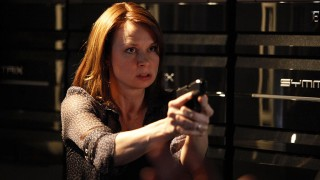Chloe O'Brian wields a gun inside CTU in 24 Season 8 Episode 13