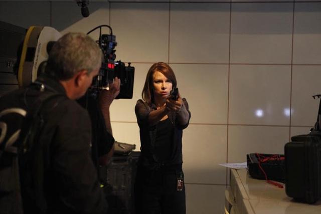 Chloe O'Brian with a gun in 24 Season 8