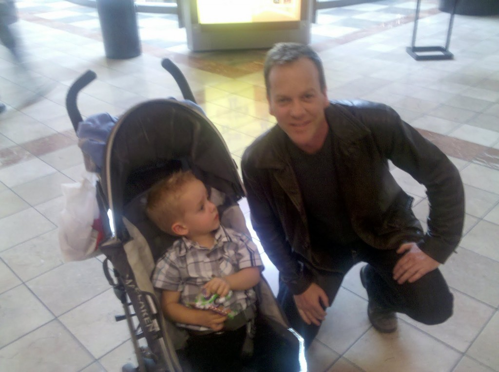 Kiefer Sutherland posing with a baby