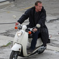 Kiefer Sutherland riding scooter behind the scenes