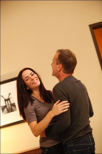 Annie Wersching and Kiefer Sutherland laugh behind the scenes