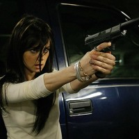 Mandy (Mia Kirshner) with gun in 24 Season 4 finale