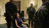 Benjamin Juma (Tony Todd) takes Olivia Taylor hostage