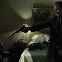 Kiefer Sutherland in The Confession pointing gun