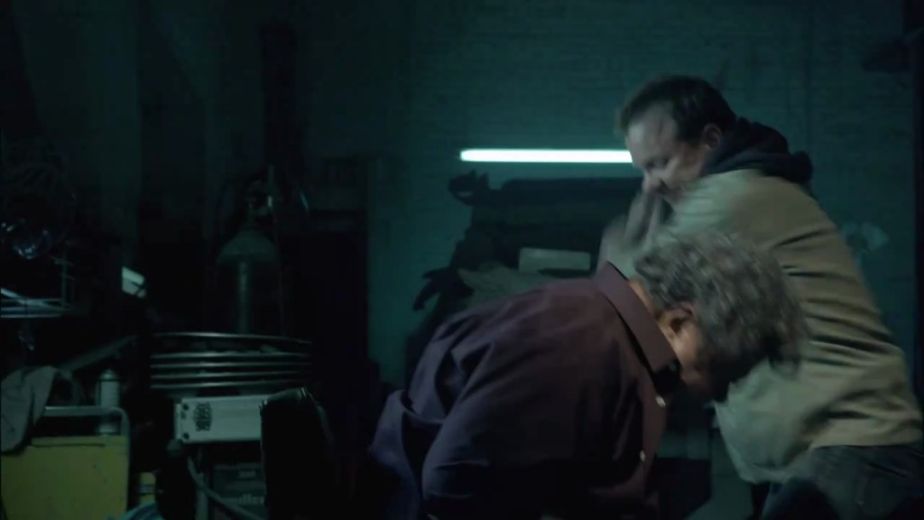 Kiefer Sutherland in The Confession beating guy