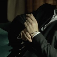 Kiefer Sutherland in The Confession handcuffs