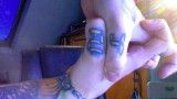 24 logo tattoo thumbs