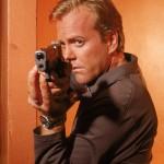 Kiefer Sutherland as Jack Bauer pointing gun