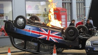 An overturned Union Jack cab in 24: Live Another Day promotional video shoot