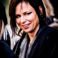 Mary Lynn Rajskub smiling on 24: Live Another Day Set - January 28, 2014
