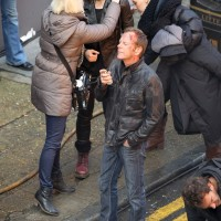 The makeup team works on Mary Lynn Rajskub and Kiefer Sutherland between takes
