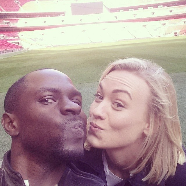 Gbenga Akinnagbe and Yvonne Strahovski goof off while filming 24: Live Another Day at Wembley Stadium