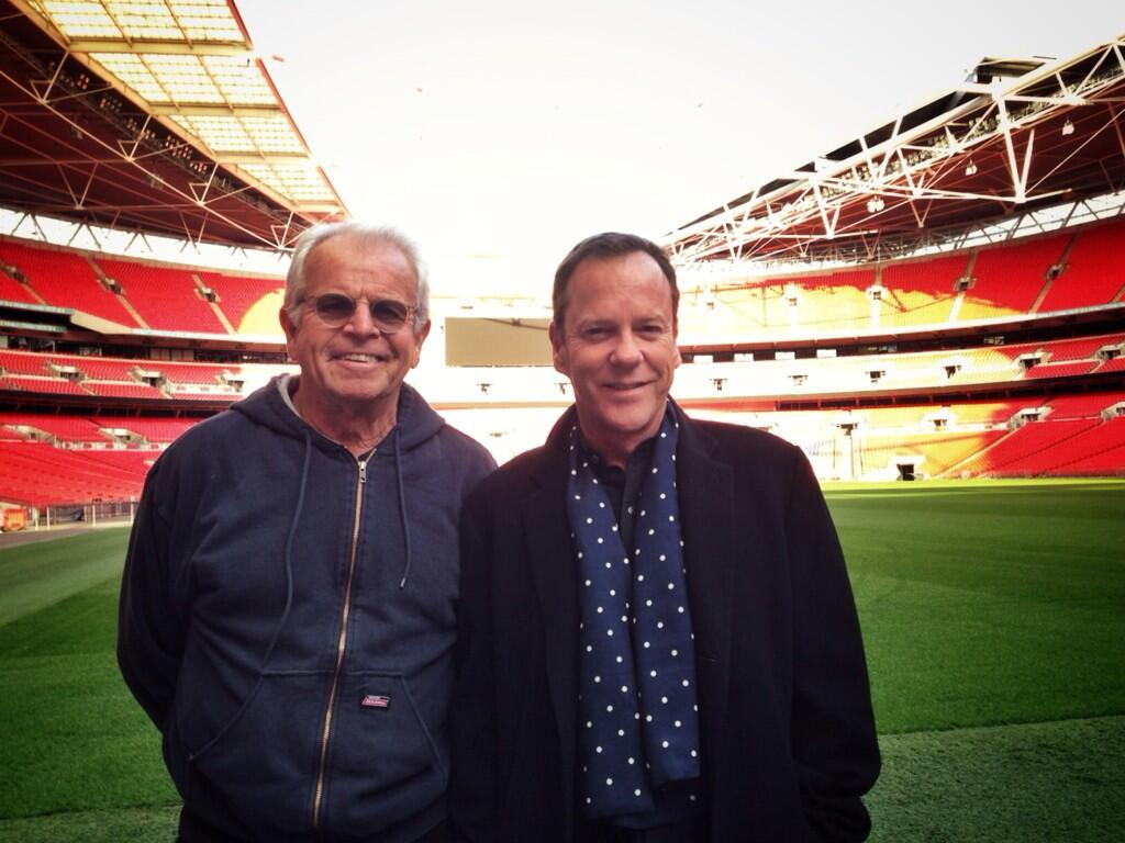 William Devane and Kiefer Sutherland pose for a photo in Wembley Stadium while filming 24: Live Another Day