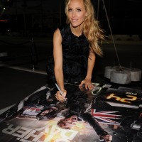 Kim Raver signs posters at 24: Live Another Day premiere screening in NYC