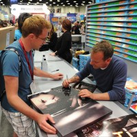 Kiefer Sutherland signing posters at San Diego Comic-Con 2014