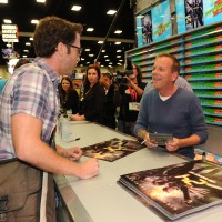 Kiefer Sutherland greeting a fan at San Diego Comic-Con 2014