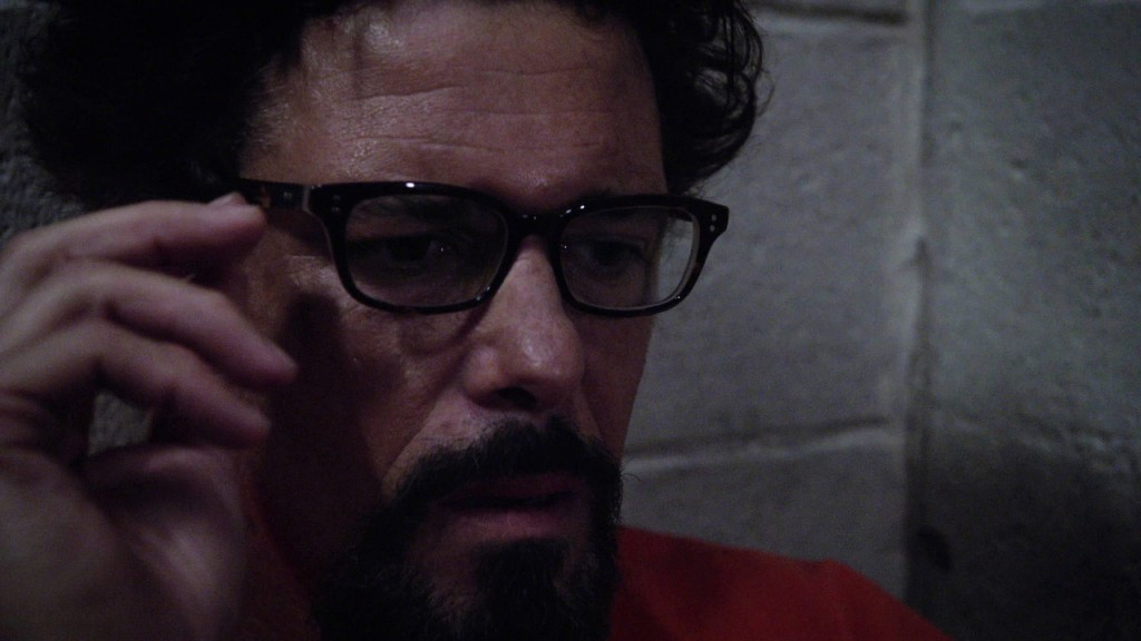Tony Almeida tries on glasses in 24: Solitary