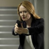Rebecca Ingram with gun inside CTU - 24: Legacy Episode 9